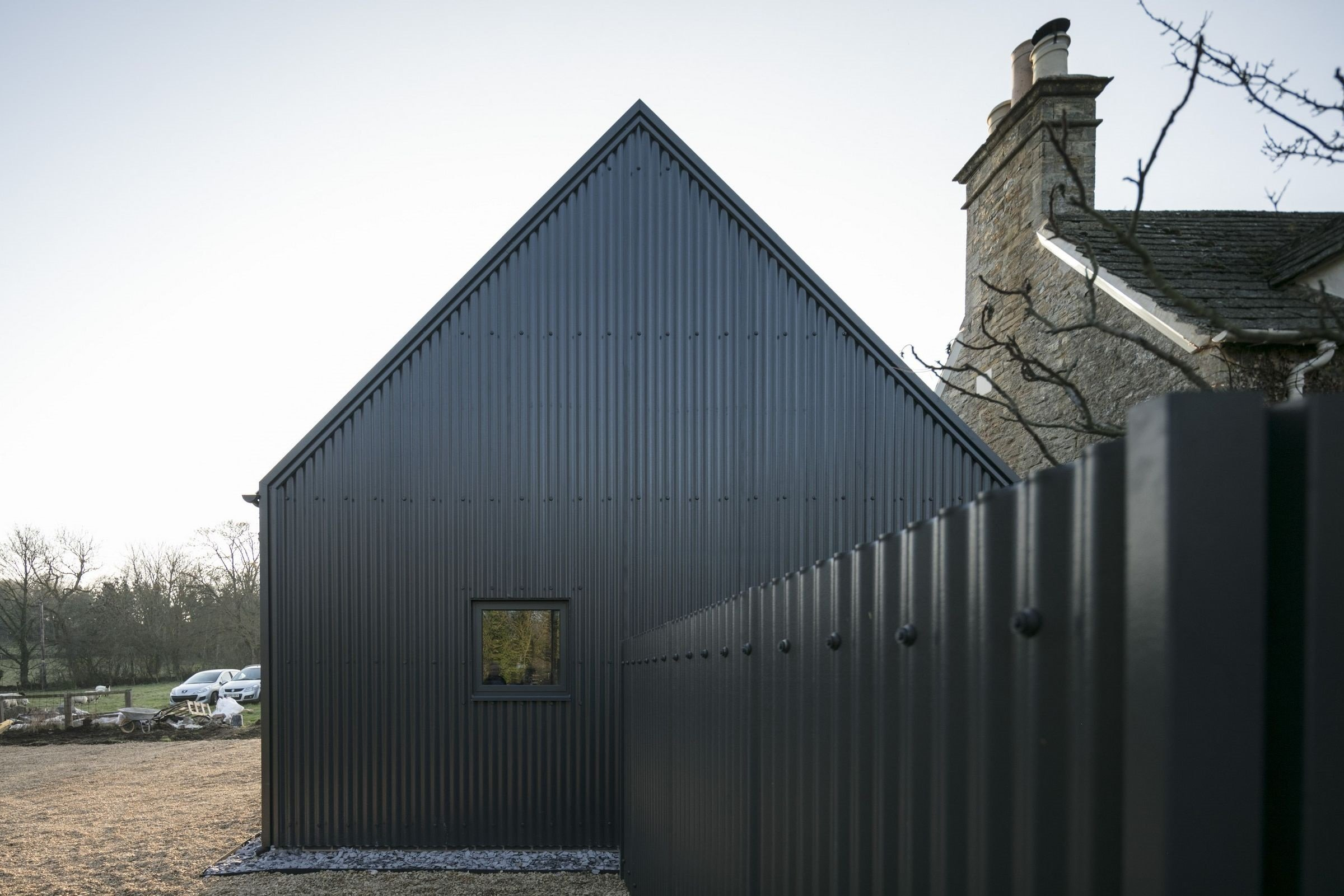 Corrugated Sheets in Anthracite with custom flashing detail around edging