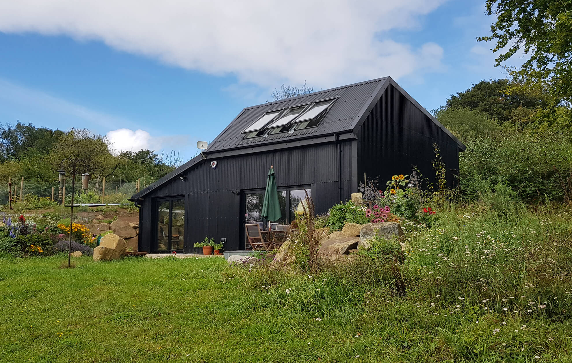 Cladco Corrugated Roofing Sheets In Black Give This Build Both Symmetry and Beauty