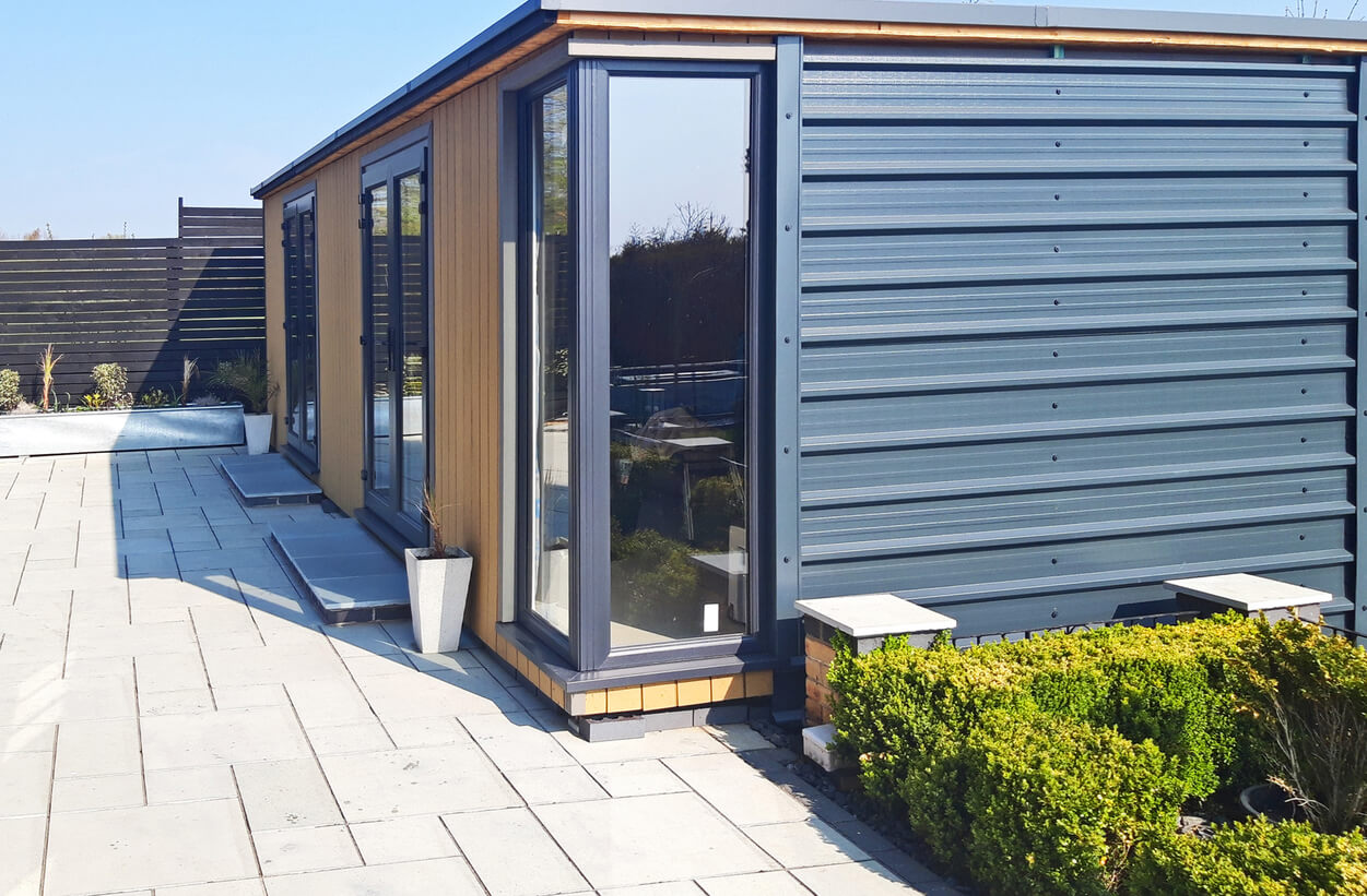 A modern garden building has been designed using 32/1000 Box Profile Roofing Sheets as side cladding