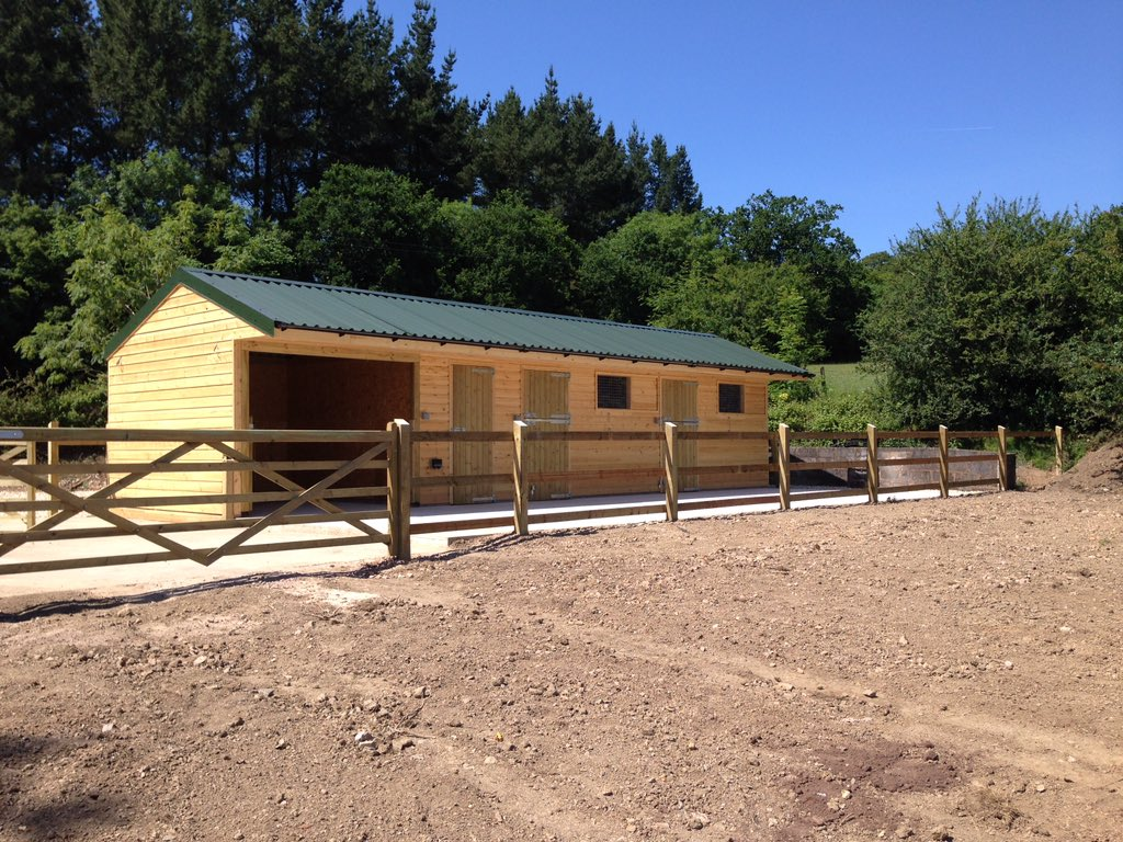 Stable Yard with added storage using Cladco Box Profile Roofing Sheets in Juniper Green