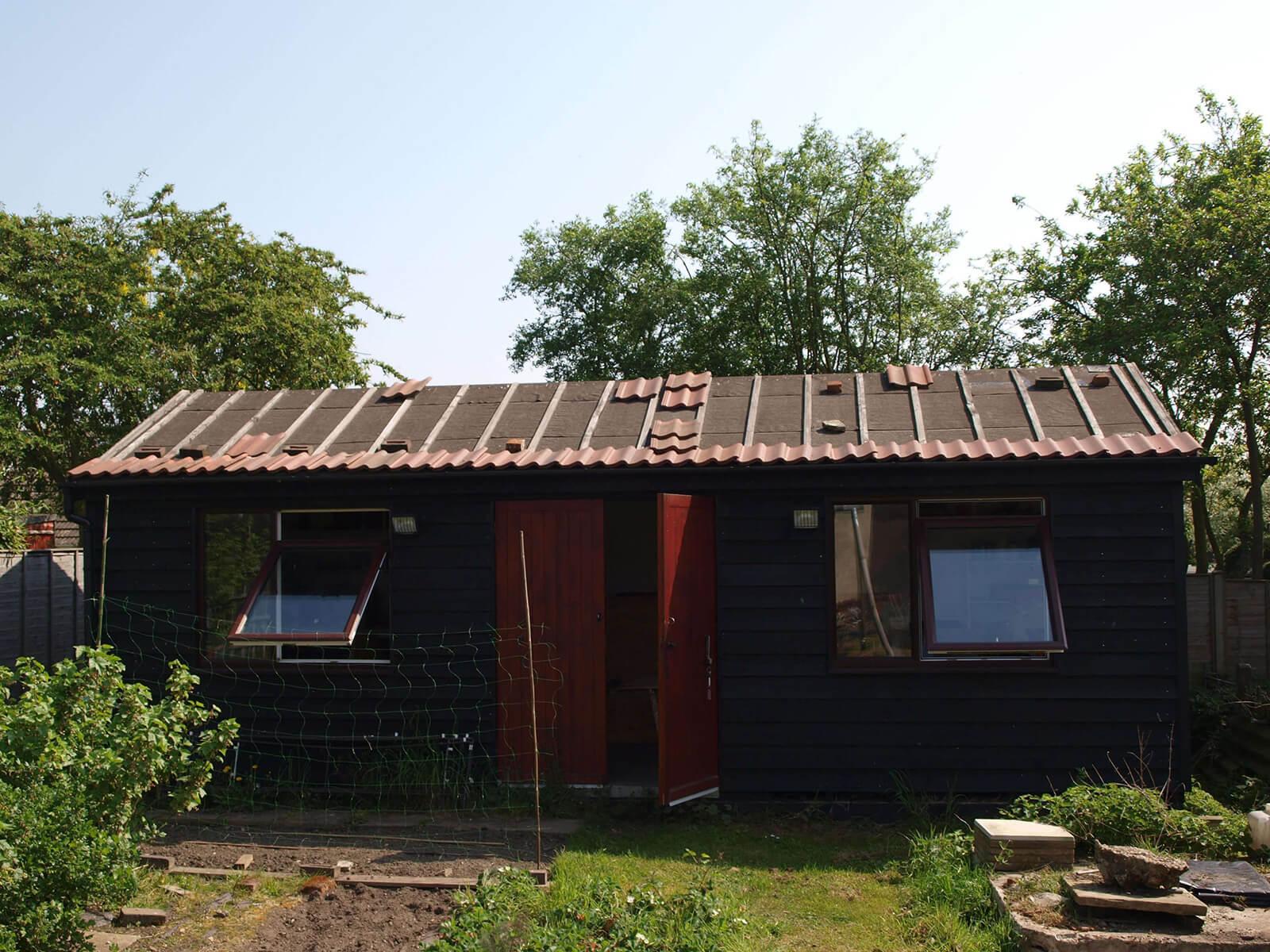Copper Brown Tileform Sheeting on garden shed.