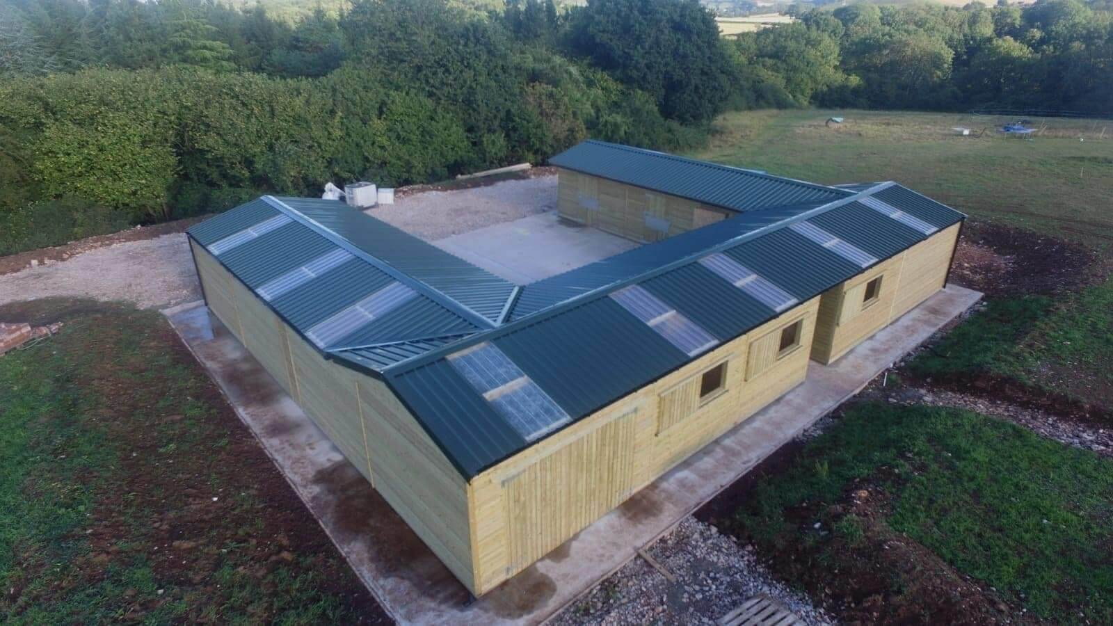 PVC Juniper Green roofing sheets give this stables a modern, yet culturally sound look without impeaching on the surrounding countryside