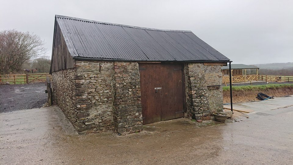 Before and after of stone barn with Anthracite PVC Corrugated Sheeting