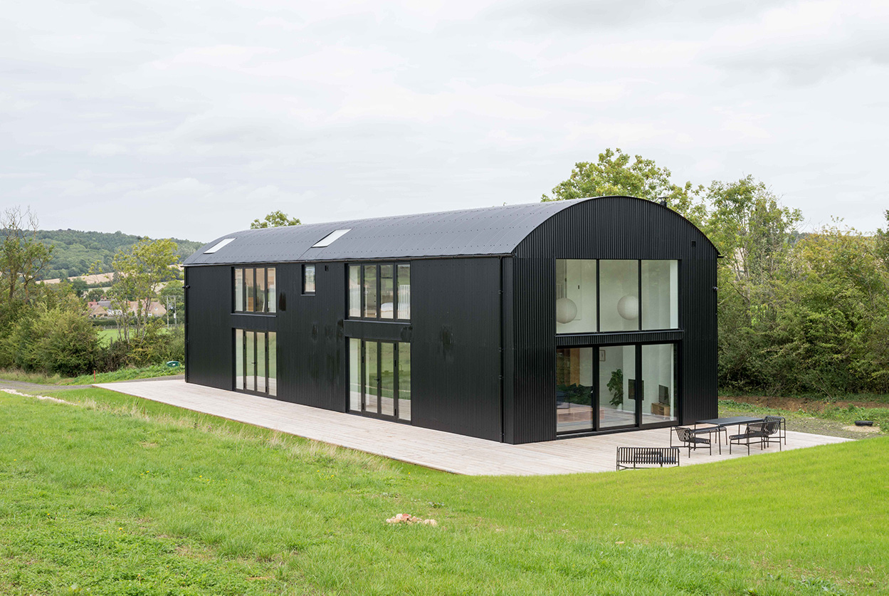 Traditional barn conversion home has been magnificently designed using Cladco Corrugated Black Roofing sheets