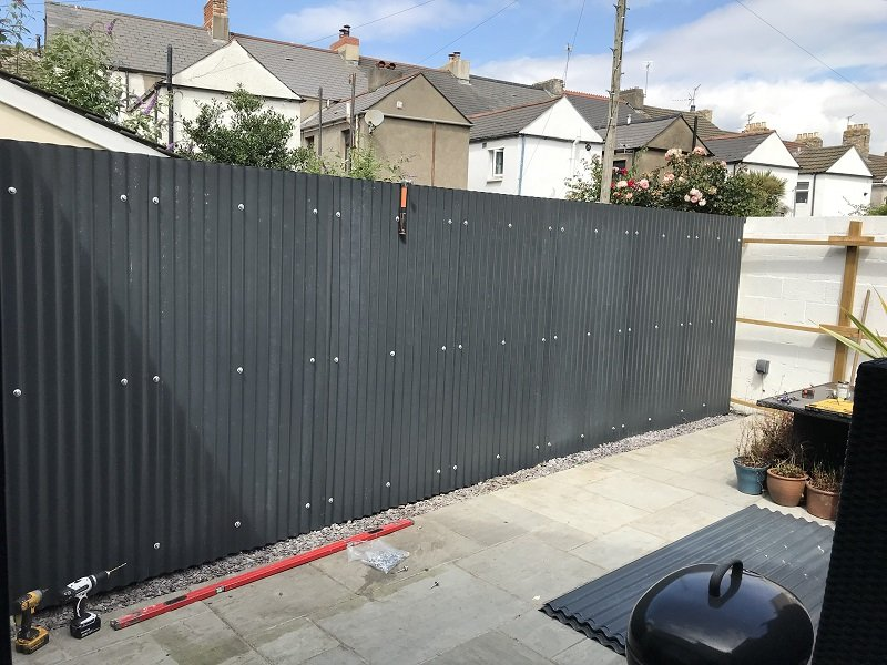 Black Corrugated Cladding Sheets in garden