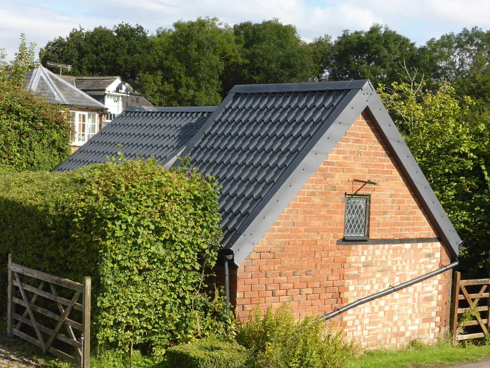 Graphite Grey Tile form sheeting on stone barn