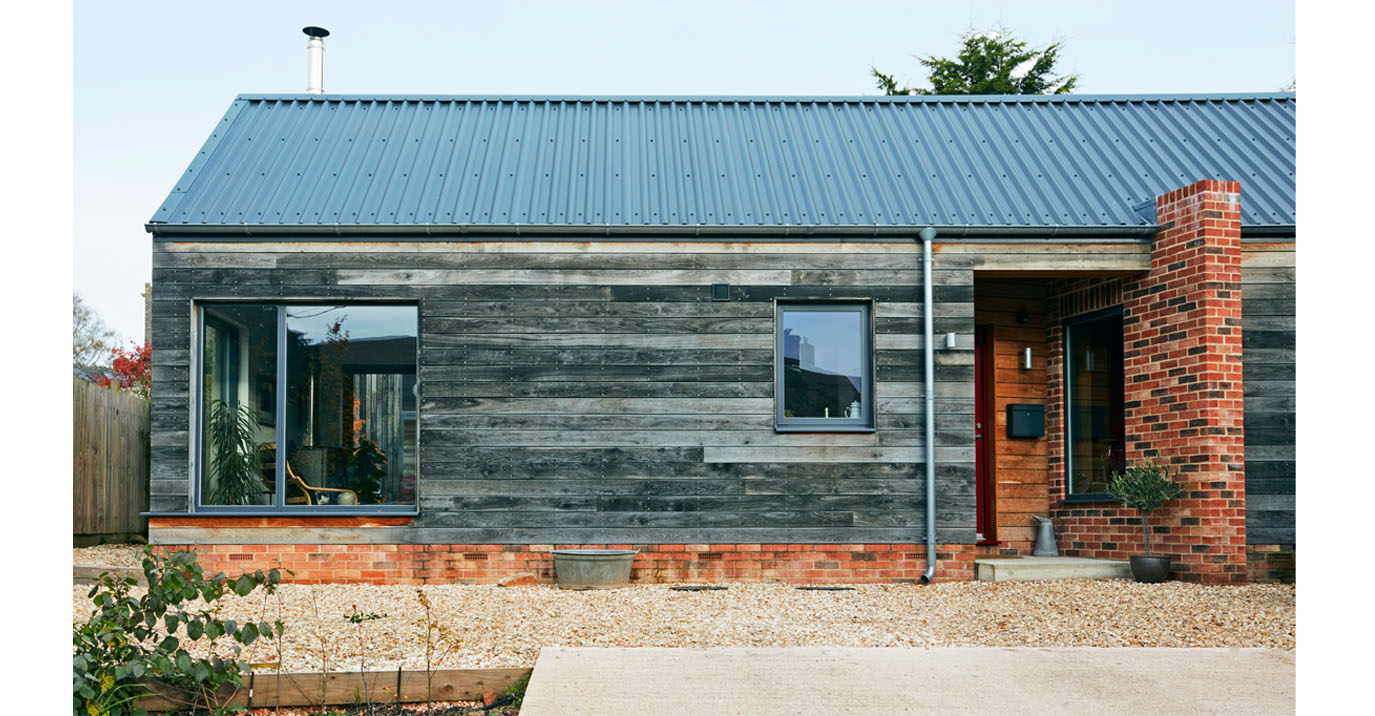 A Scandinavian-inspired rural home features Cladco Steel Box Profile Roofing Sheets