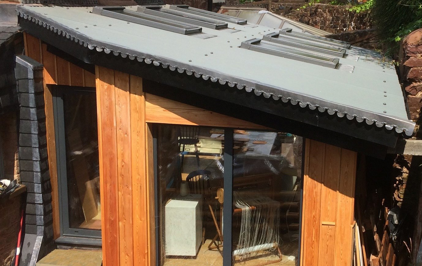 This Garden Studio was created using Cladco Bespoke Roofing sheets in light grey with Velux windows for extra light.