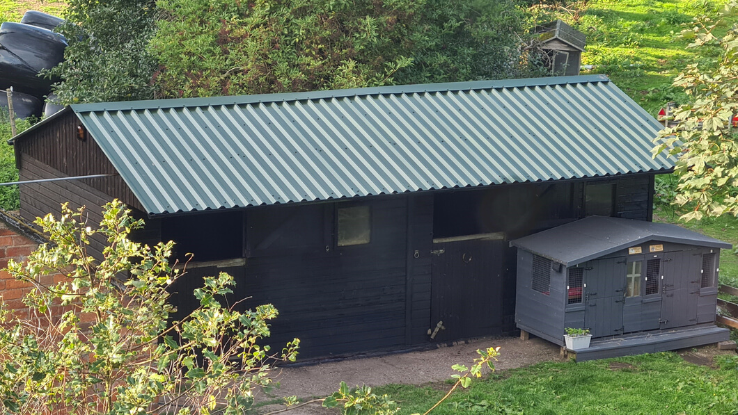 Stable block with Juniper Green roofing sheets