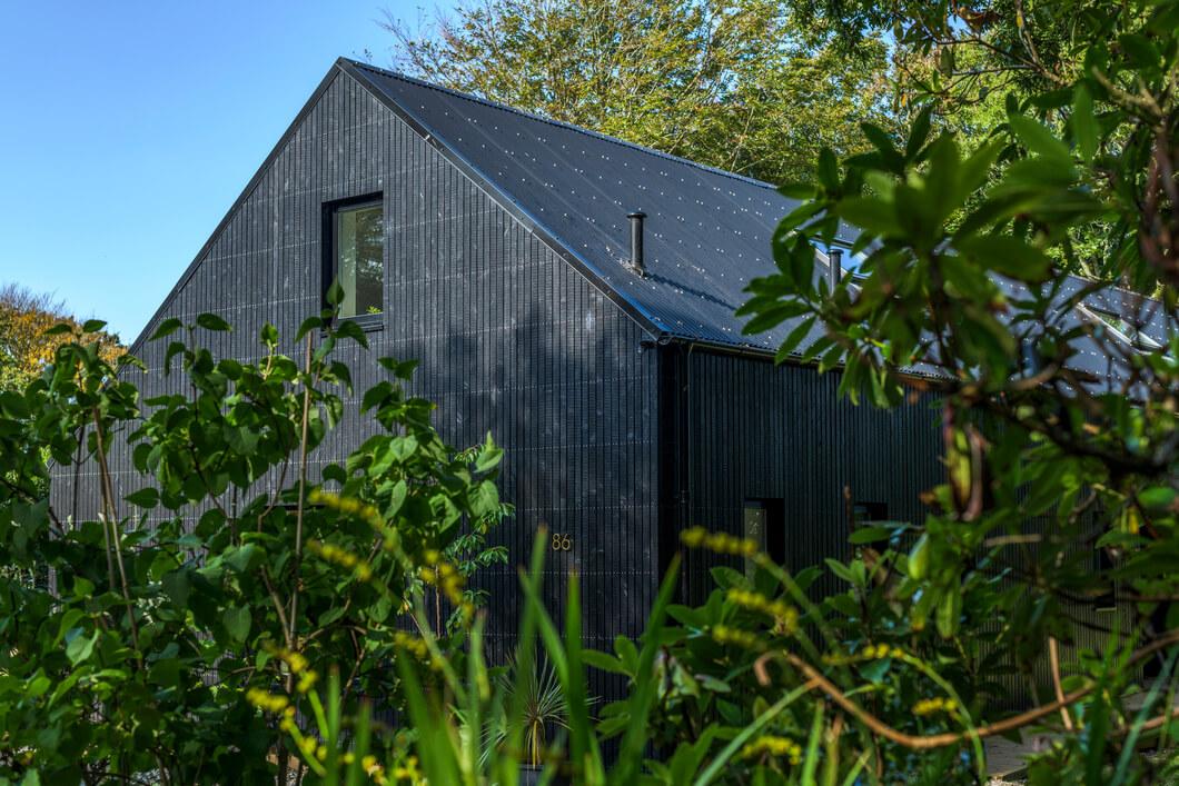 Fairfield Barn behind shrubbery